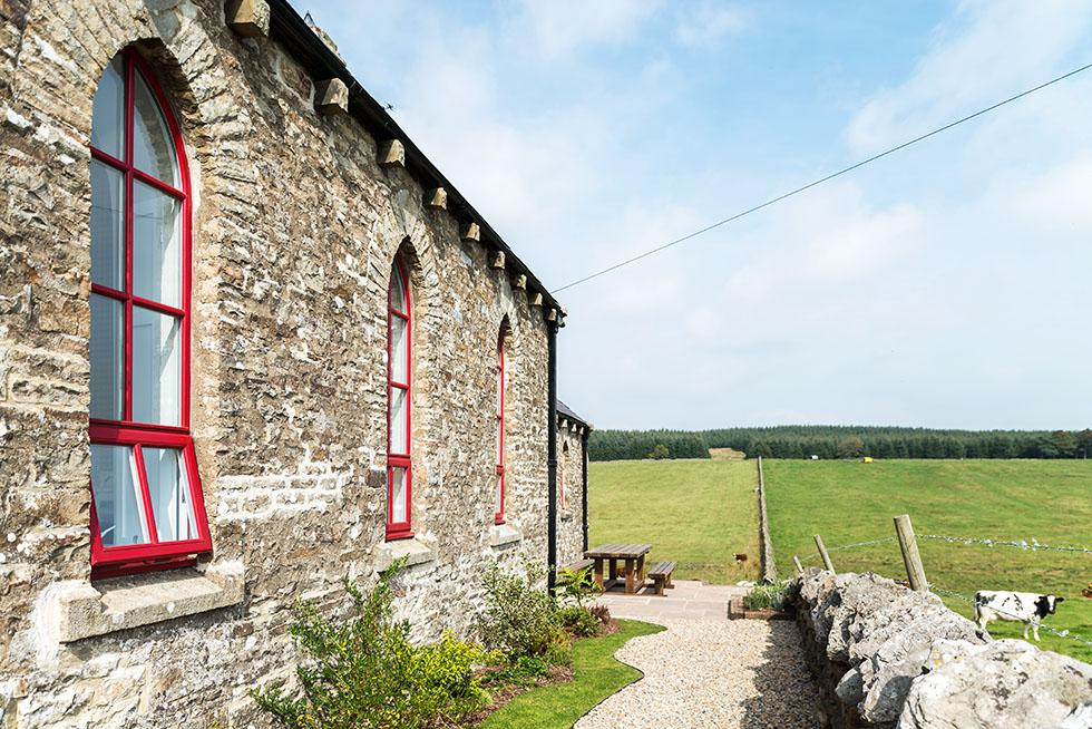 Camenzind-chapel-conversion-exterior-windows-patio