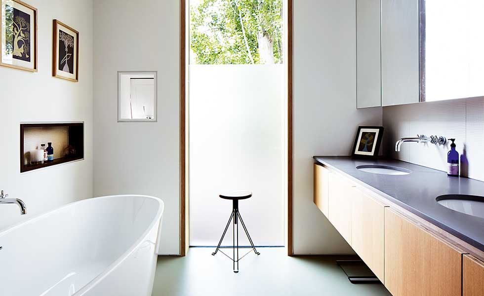 contemporary bathroom with freestanding bath and obscured glass window