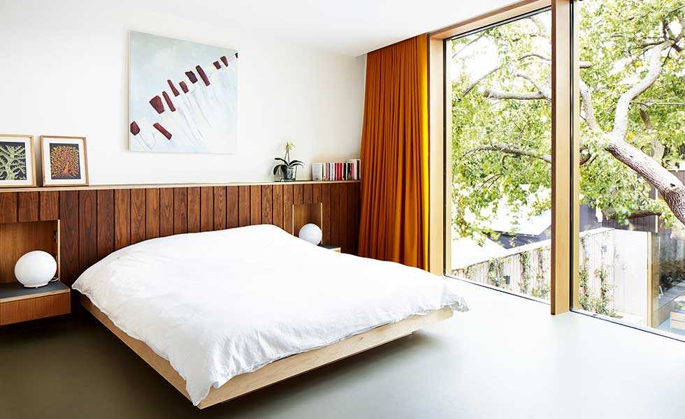 contemporary bedroom with floor to ceiling window
