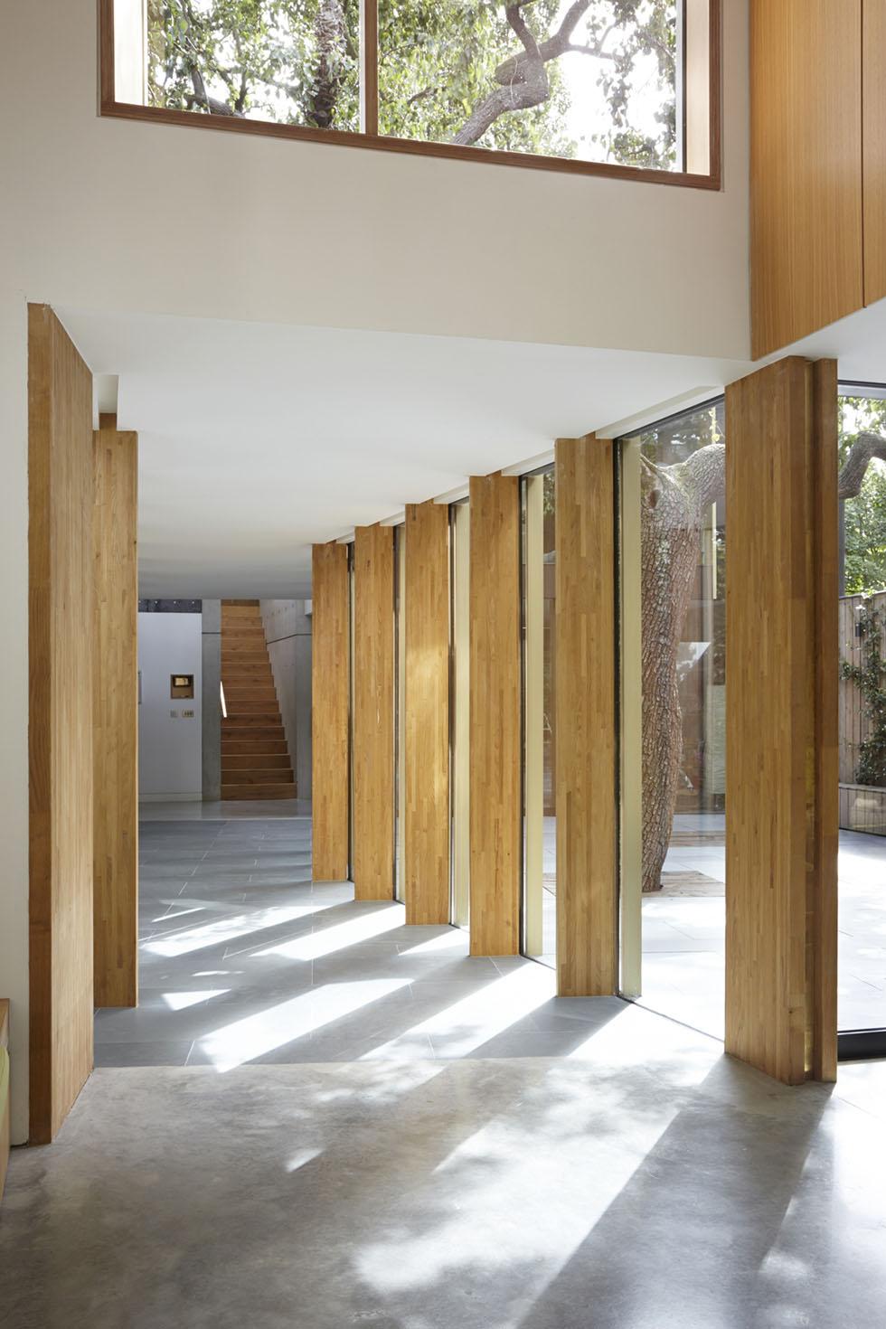glass corridor with wooden vertical beams