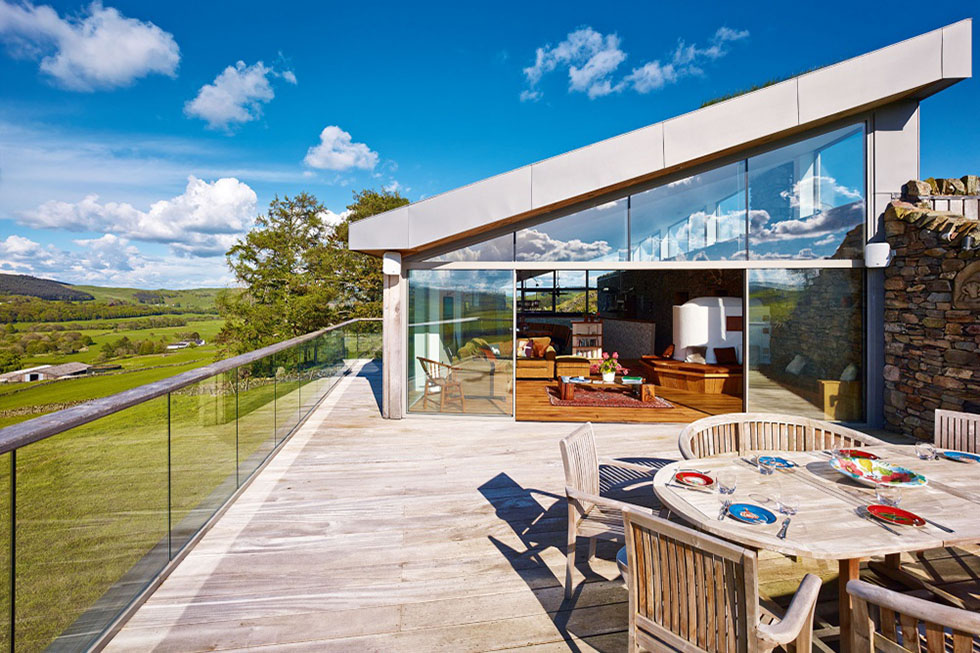A living area opens out onto a roof deck for al fresco dining, taking advantage of upside-down living to maximise rural views across the 300-acre site. View Project →
