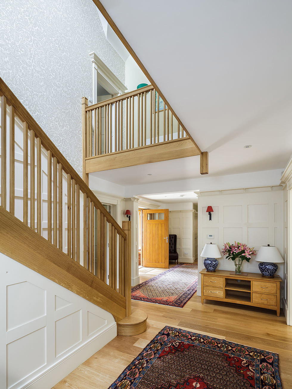 hallway in arts and crafts home with wooden staircase