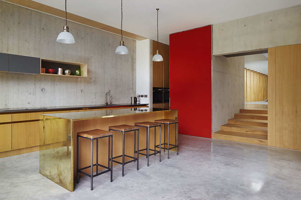 concrete floored kitchen with pendant lights