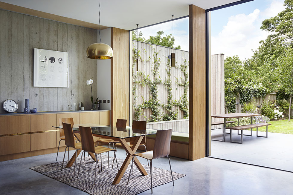 dining room with concrete floor and glazing