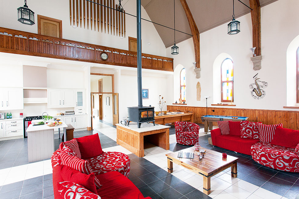 A relaxed open plan scheme is offered, with a stove acting as a focal point to warm this converted church and ensure a cosy seating area. View Project →