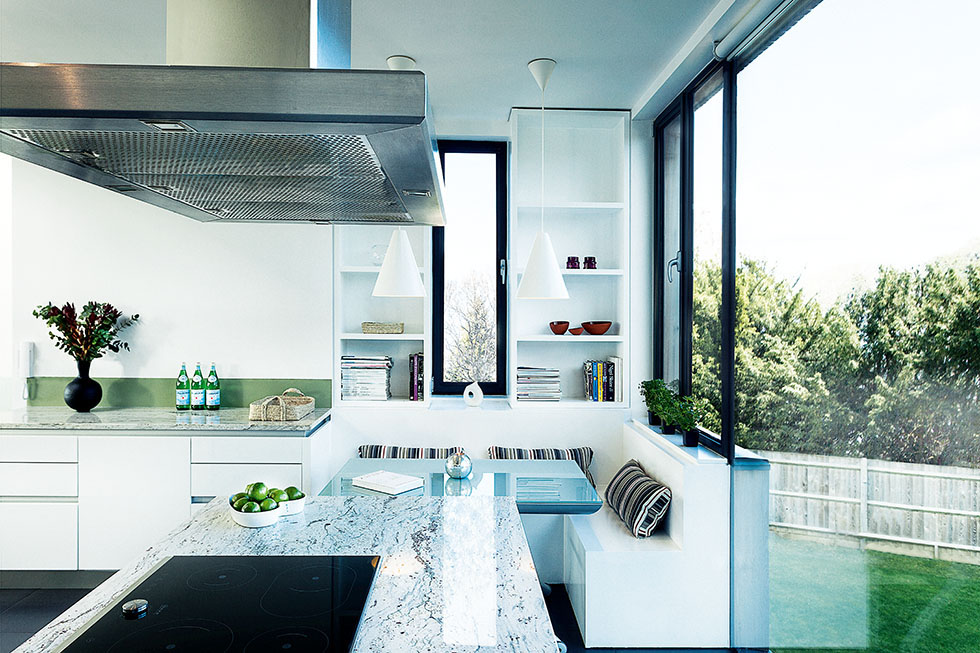 A snug kitchen seating area has been built beside the window to maximise views. View Project →