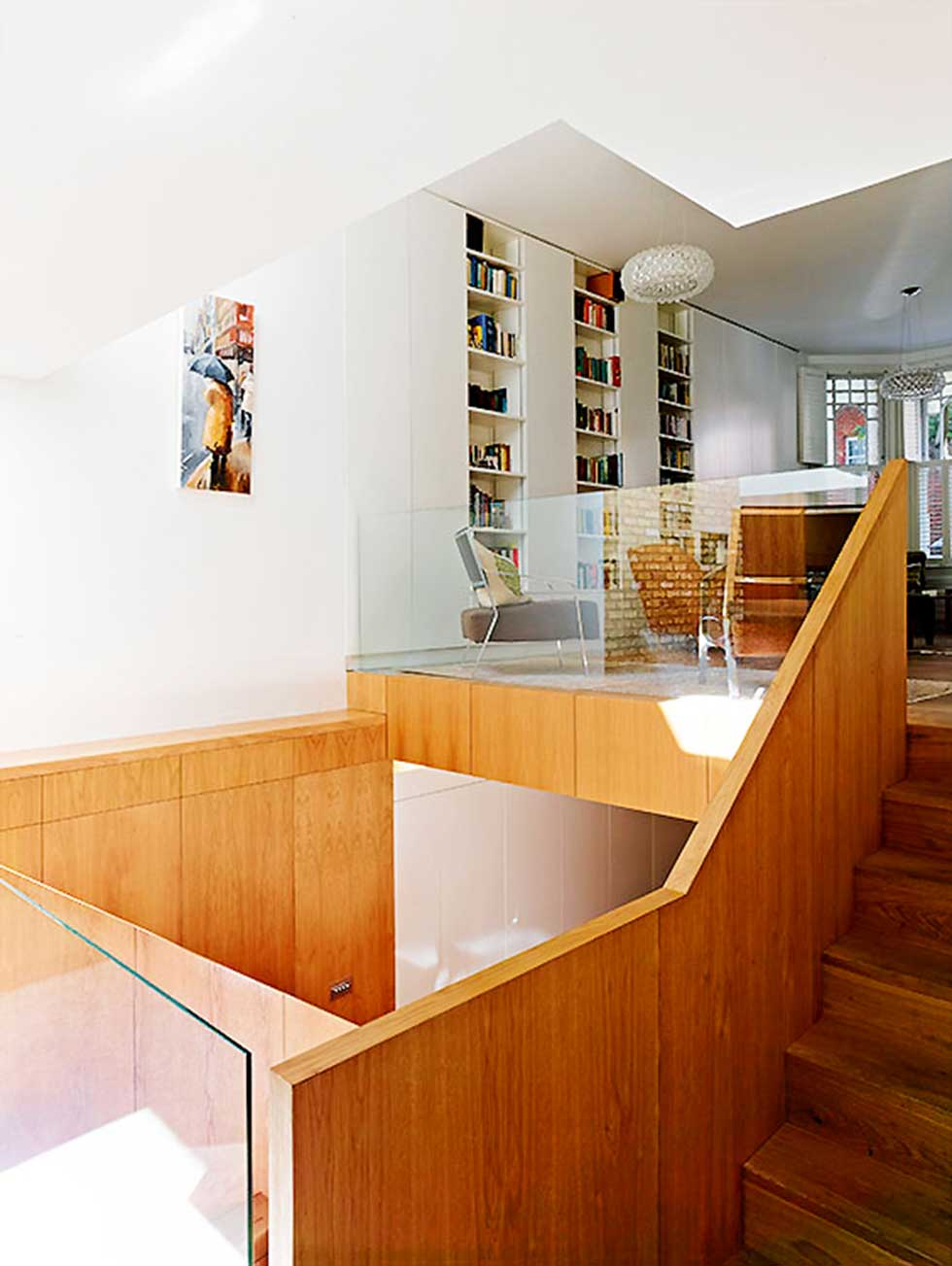 wood and white wall stairs and light well in an Edwardian extension and remodel