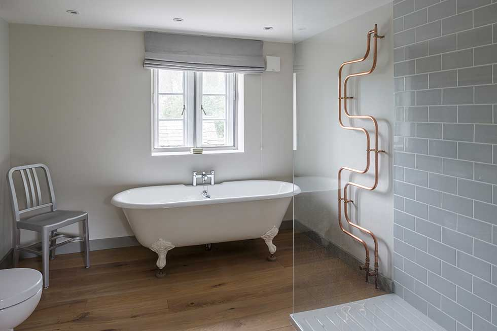 listed cottage renovation bathroom with copper pipes