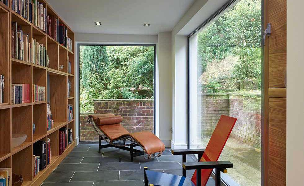 book shelves in a library with large windows