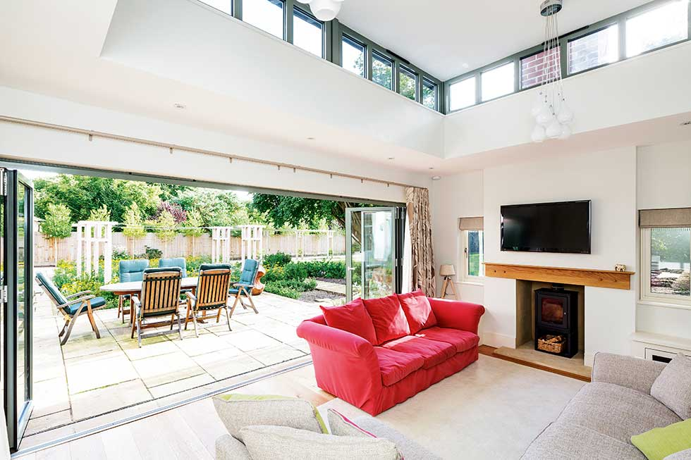 arts & crafts style self build house rooflight living area