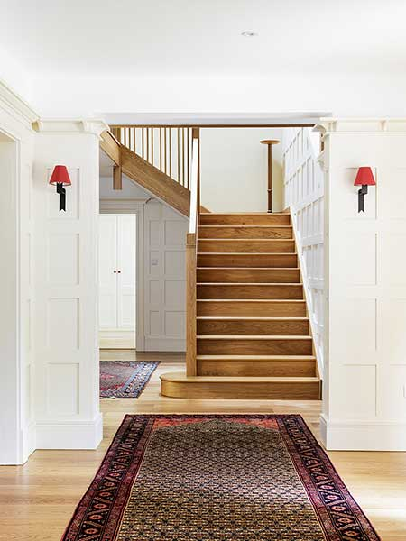 arts & crafts style self build house wood staircase entrance