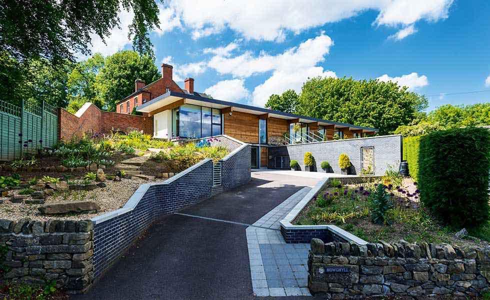 a contemporary self-build built on a sloping garden plot