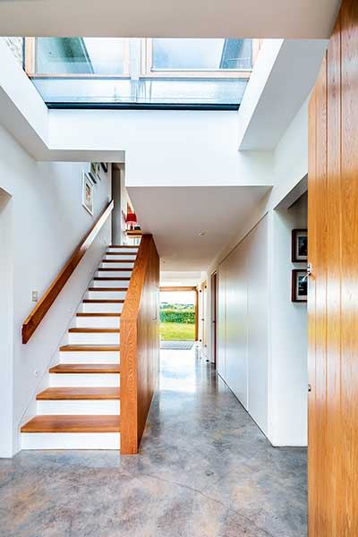 Old cottage extension wood staircase in glazed link