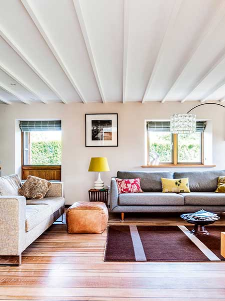 Old cottage extension cosy living room white beams
