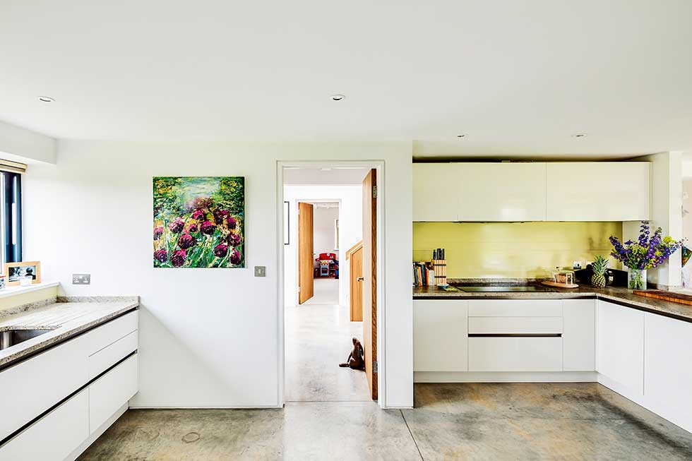 Old cottage extension open plan kitchen diner yellow splashback