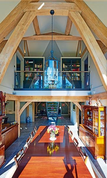 Oakwrights timber frame home double height dining room mezzanine