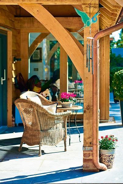 Oakwrights timber frame home veranda seating