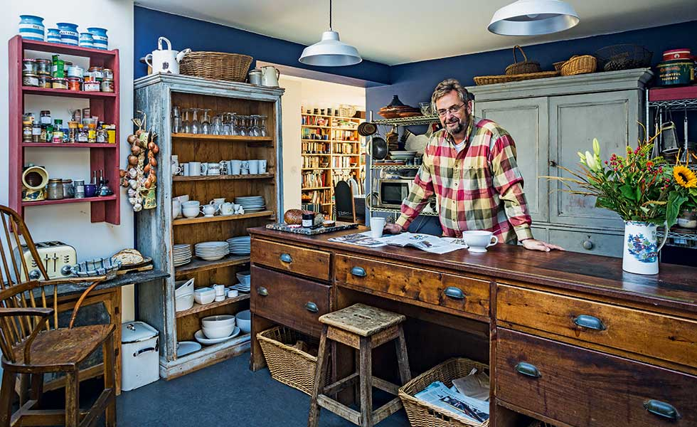 Nigel Humphrey in renovated kitchen with shopcounter and upcycled storage