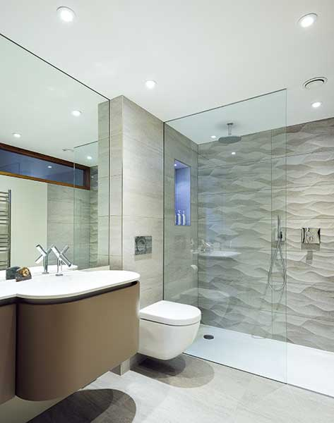 bathroom with grey tiles and walk-in shower