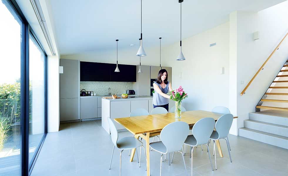Sarah Catrwright in kitchen diner of her converted bungalow