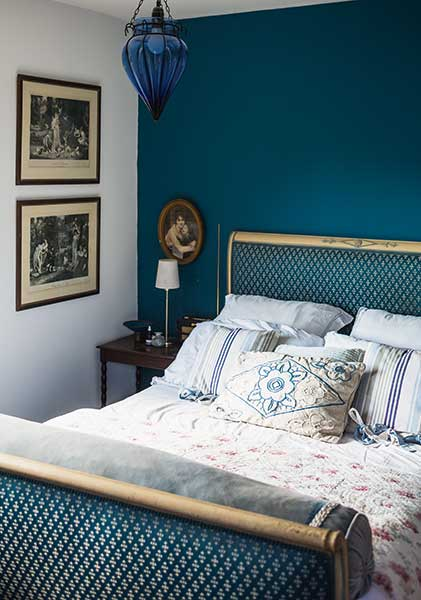 teal bedroom with sleigh bed