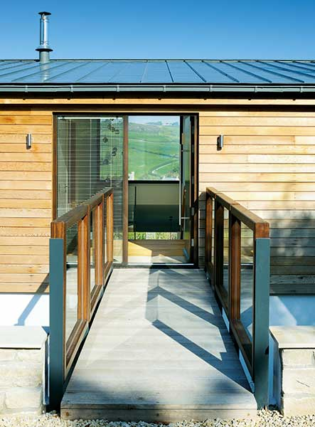 walkway to entrance and clad exterior of converted bungalow