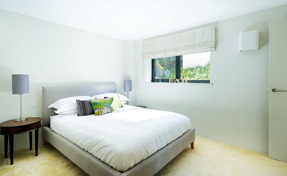 white bedroom in extended bungalow