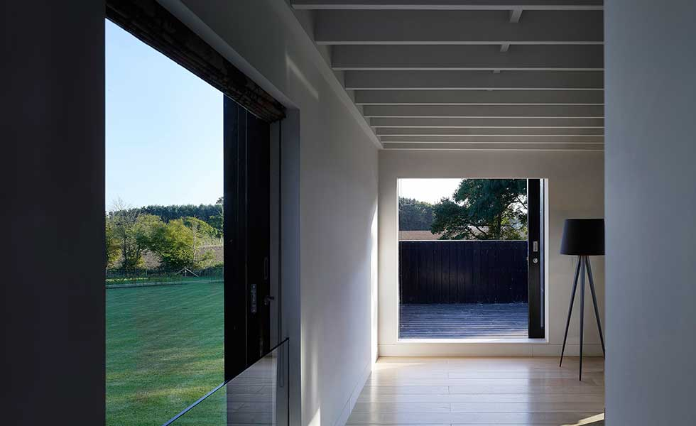 double sliding doors in modern home overlooking garden space of open plan living room