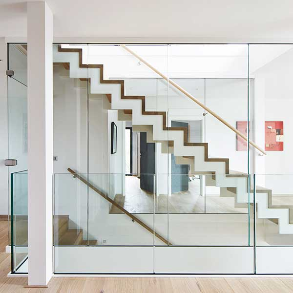 glass panels looking over double staircase with white and wood stairs
