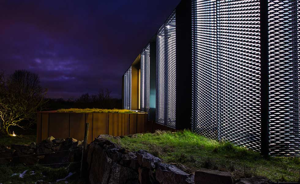 night shot of shipping container home