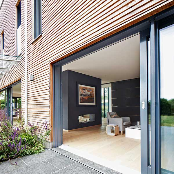 wooden panelled home with glass sliding doors