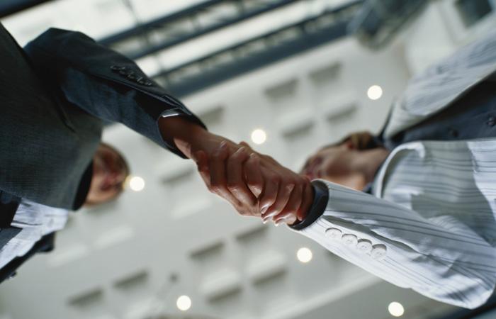 Business-Handshake-Meeting-Deal-Low-Angular-700x450.jpg