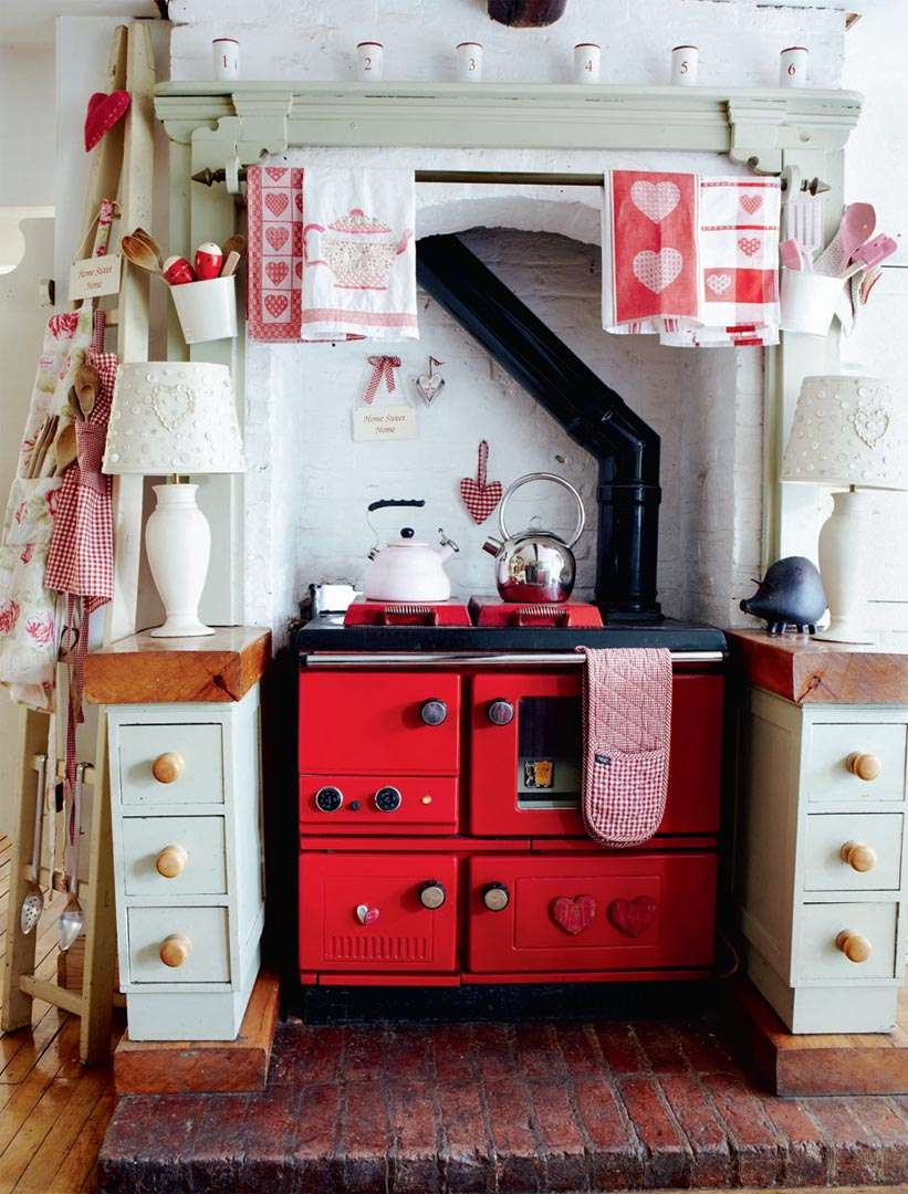 Red traditional cooker in period kitchen