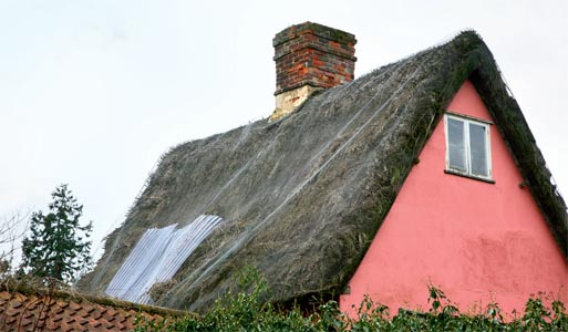 A damaged thatched roof
