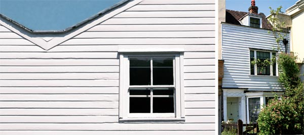 White painted softwood weatherboarding