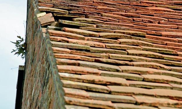 Slipped roofing tiles