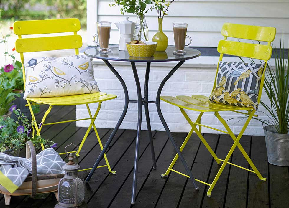 metal garden furniture painted in yellow gloss sandtex