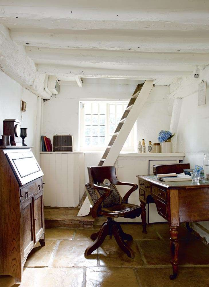 Office with bureau and ladder