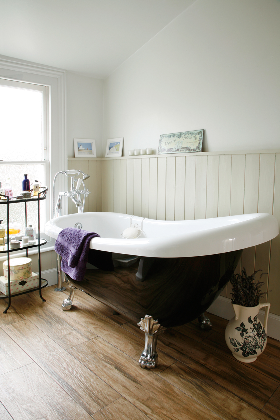 Roll-top bath from Bath Empire, with fixtures and fittings from Victorian Plumbing