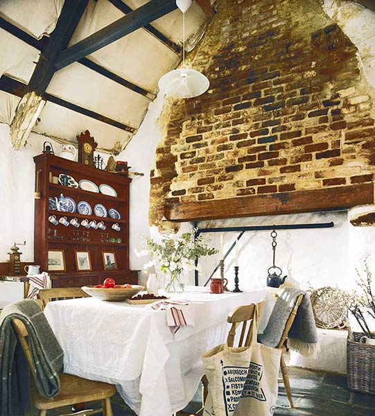 freestanding kitchen in a restored thatched cottage