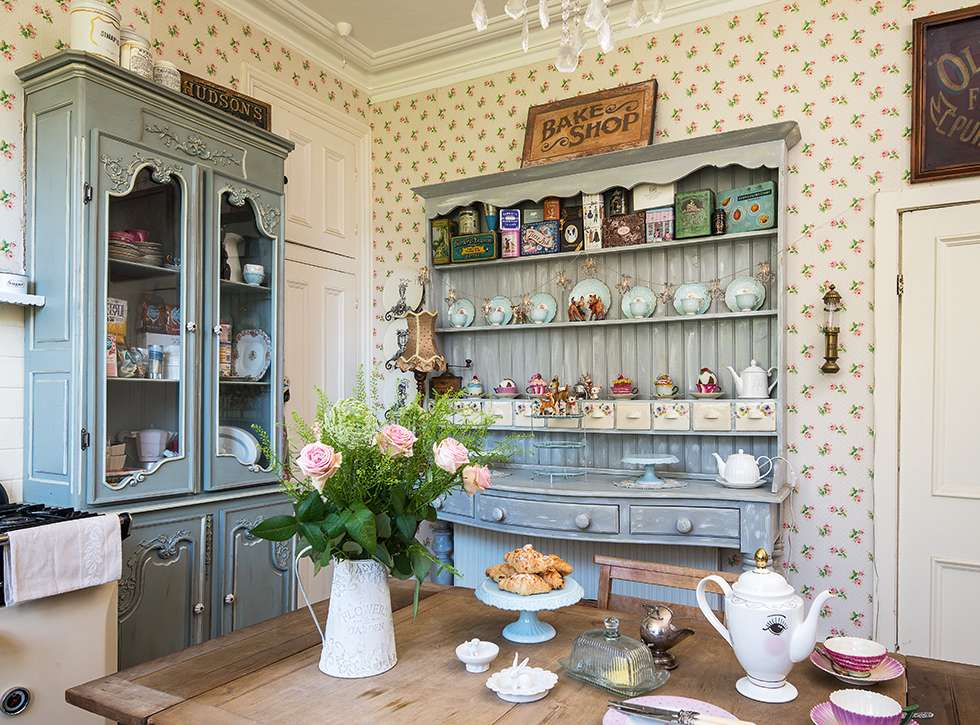 Painted dressers and wallpaper in kitchen restored