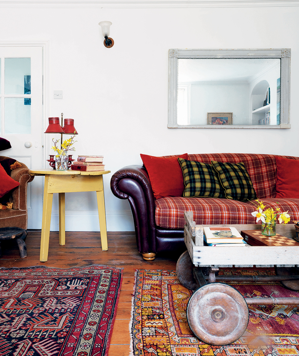 Living room with tartan upholstered sofa