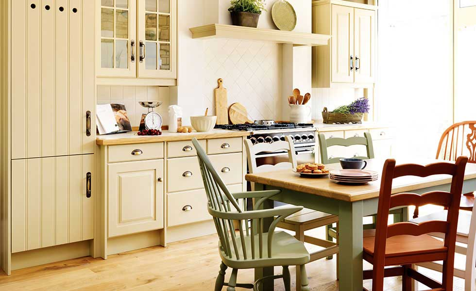 john lewis of hungerford mix and match chairs in a family kitchen