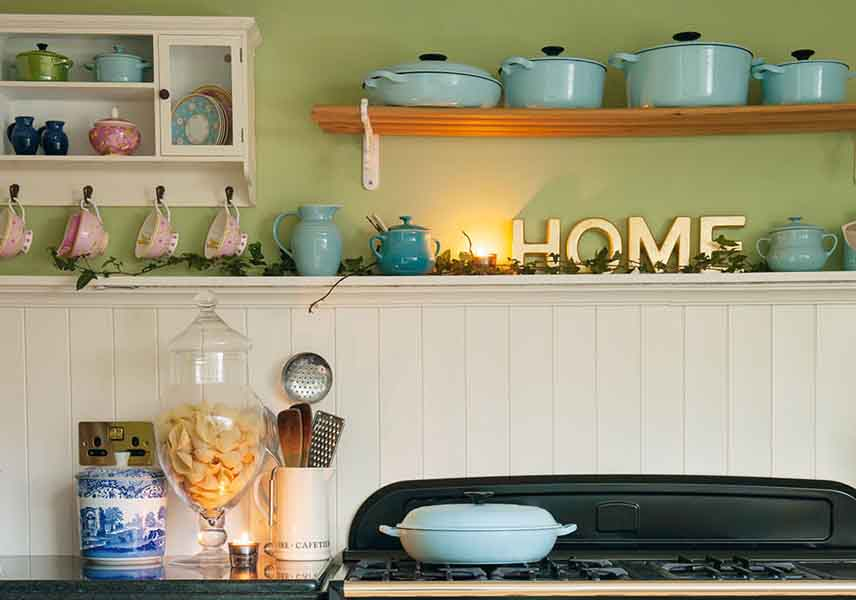 Le creuset pots on the hob in a family kitchen