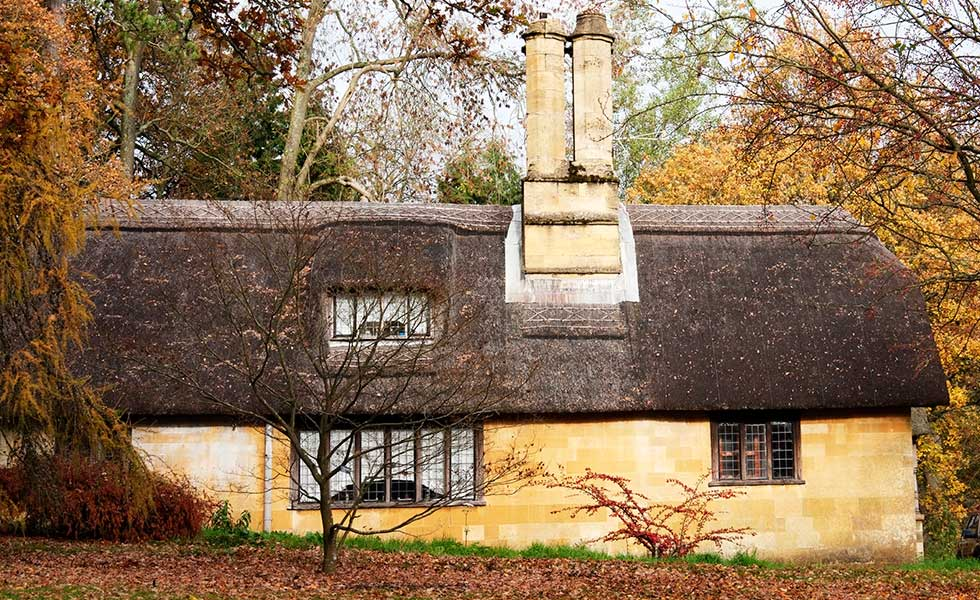 thatched cottage with dormer in autumn