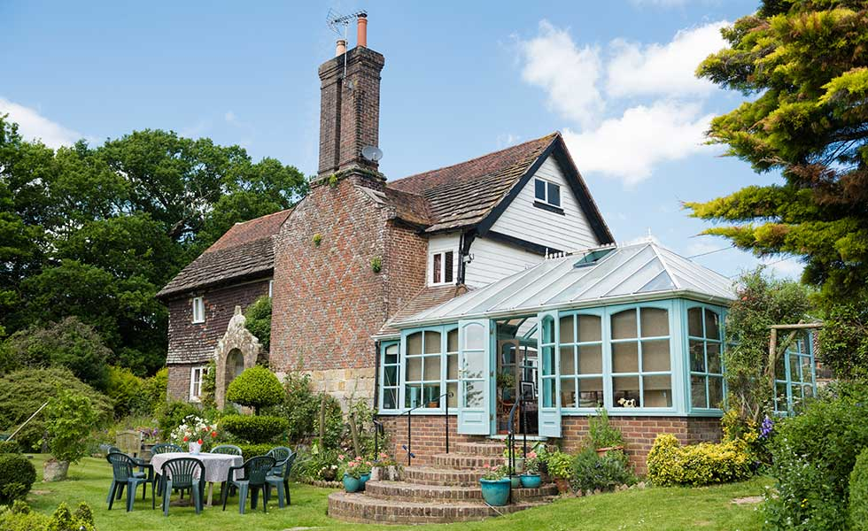 traditional home with conservatory in summer