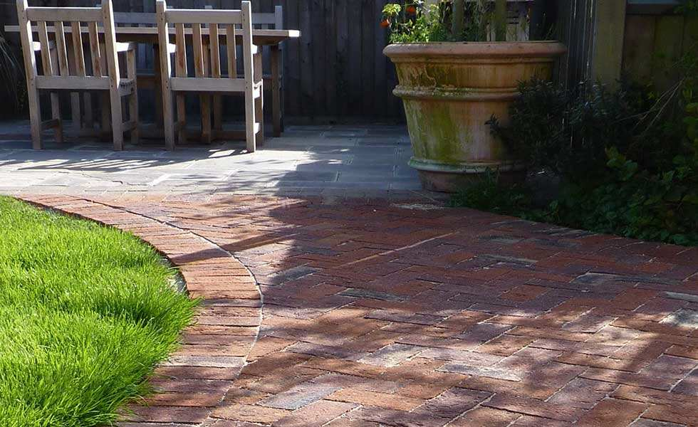Chesham Multi paving stone in a garden bordering a lawn