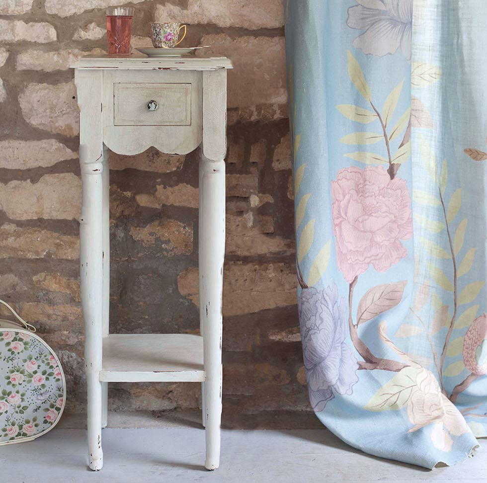 an upcycled sidetable using vintage paint effects