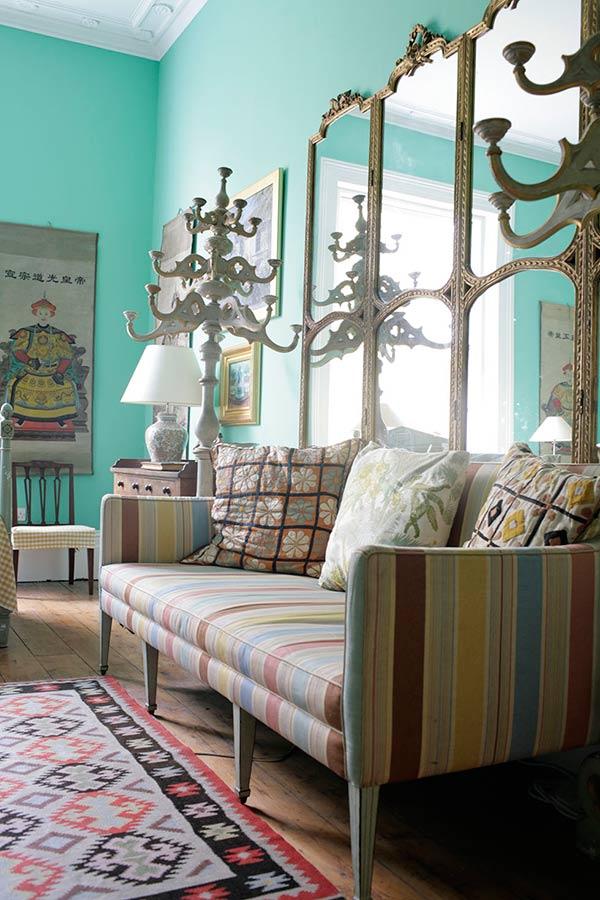 a colourful regency villa with striped sofa