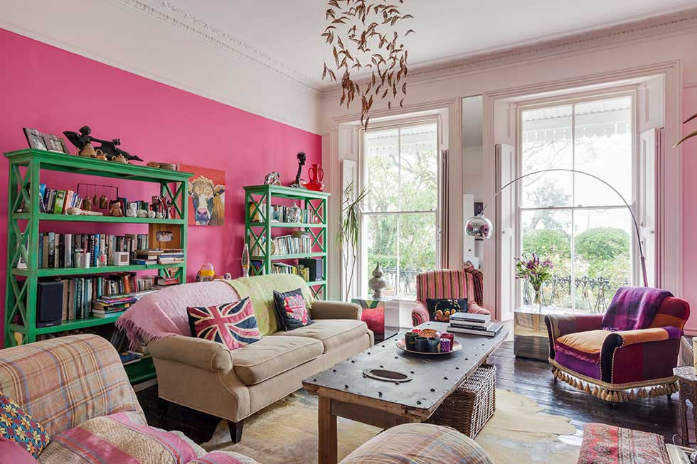 bright pink living room and seating area in a colourful victorian villa